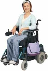 young woman sitting in wheelchair smiling